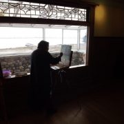 Woman painting in the Pendray House