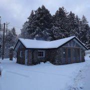 Snowy stone cottage